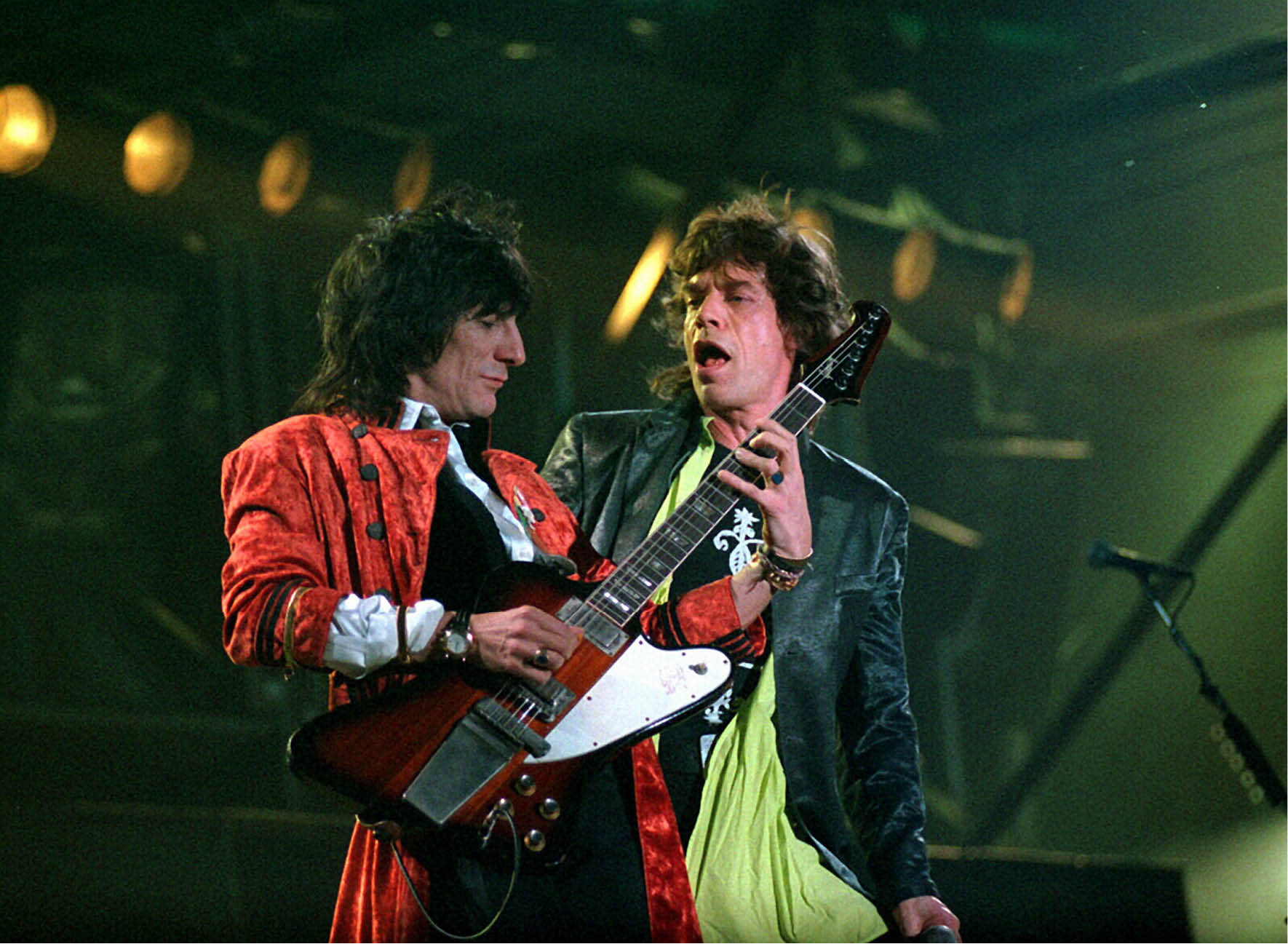 Mandatory Credit: Photo by Roy Haverkamp/Newspix / Rex Features ( 874066a ) The Rolling Stones - Ronnie Wood and Mick Jagger The Rolling Stones in concert during Australian leg of Voodoo lounge tour, Sydney Cricket Ground, Sydney, Australia - 02 Apr 1995