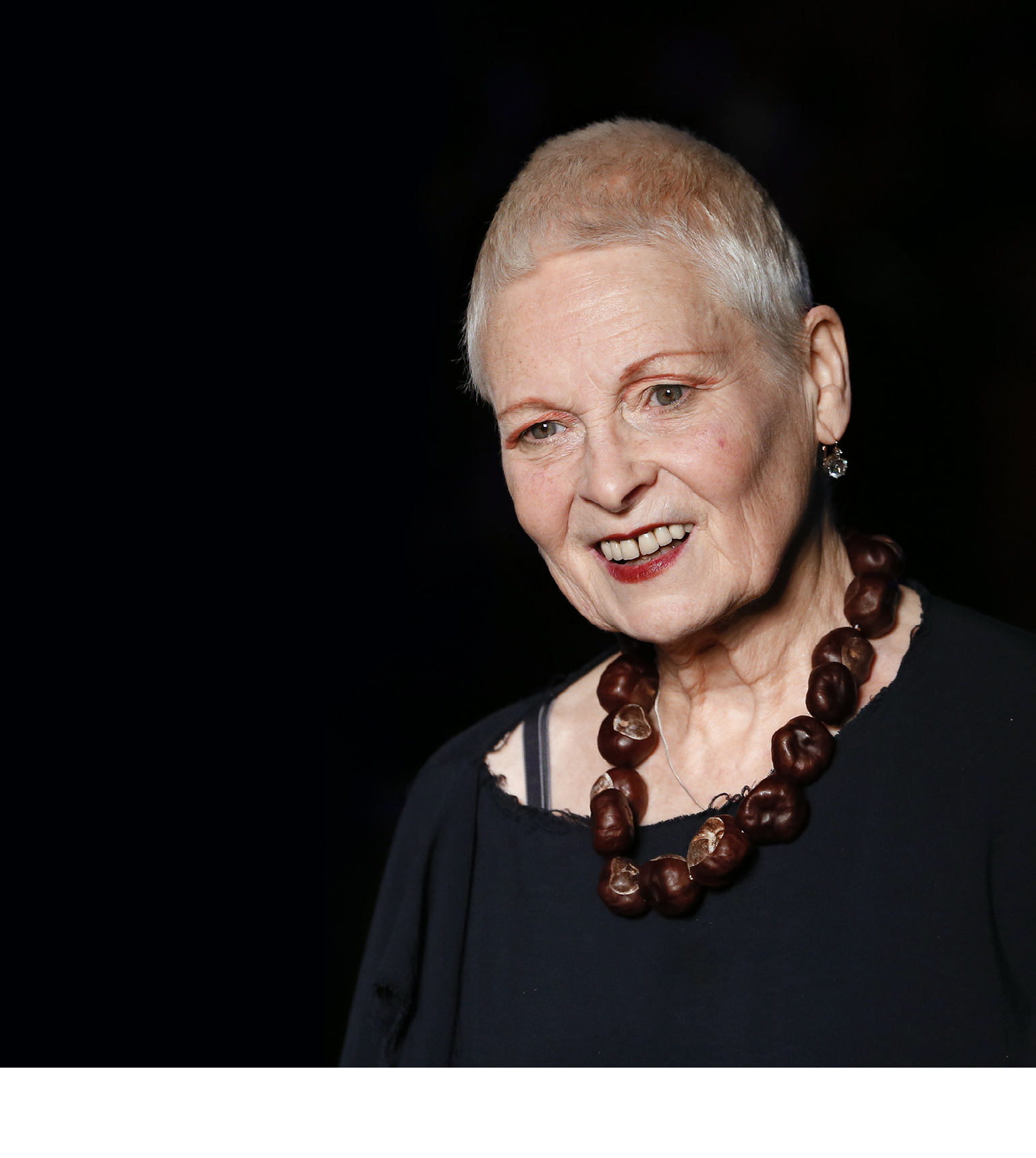 British designer Vivienne Westwood acknowledges the audience at the end of her 2015 Spring/Summer ready-to-wear collection fashion show, on September 27, 2014 in Paris. AFP PHOTO / PATRICK KOVARIK