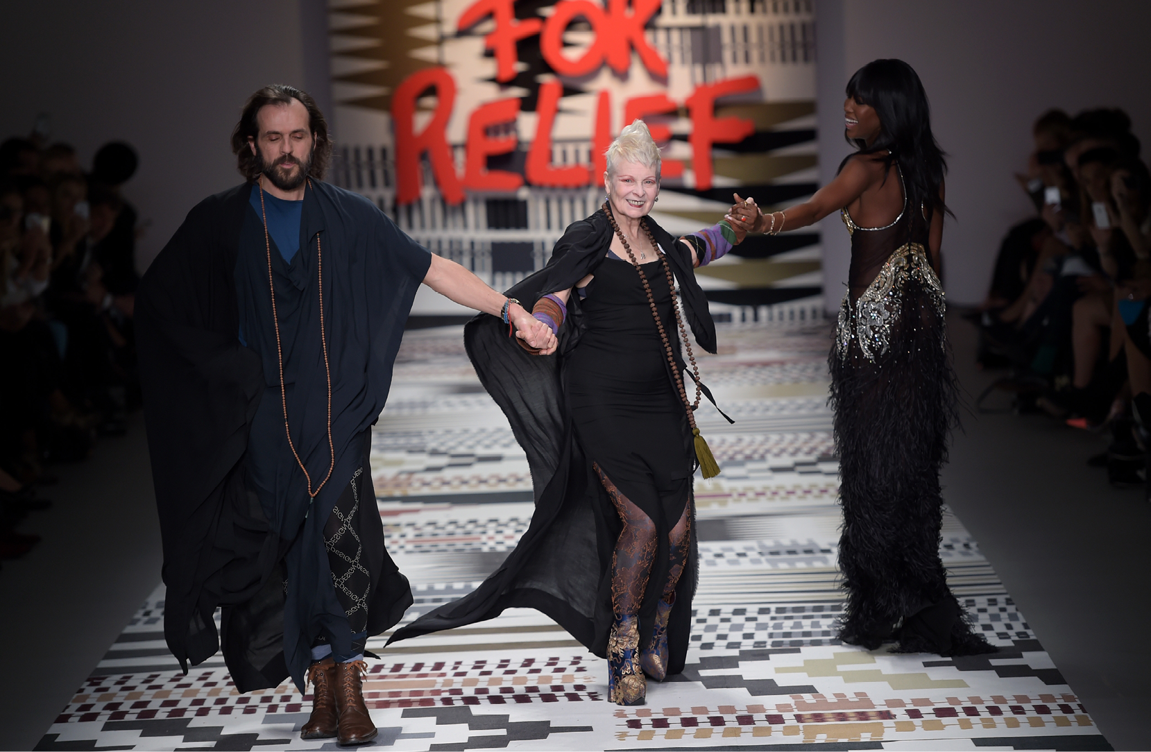 Vivienne Westwood and Andreas Kronthaler and Naomi Campbell walking the catwalk in the  Fashion For Relief charity fashion show at Somerset House, London, UK.  19/02/2015.