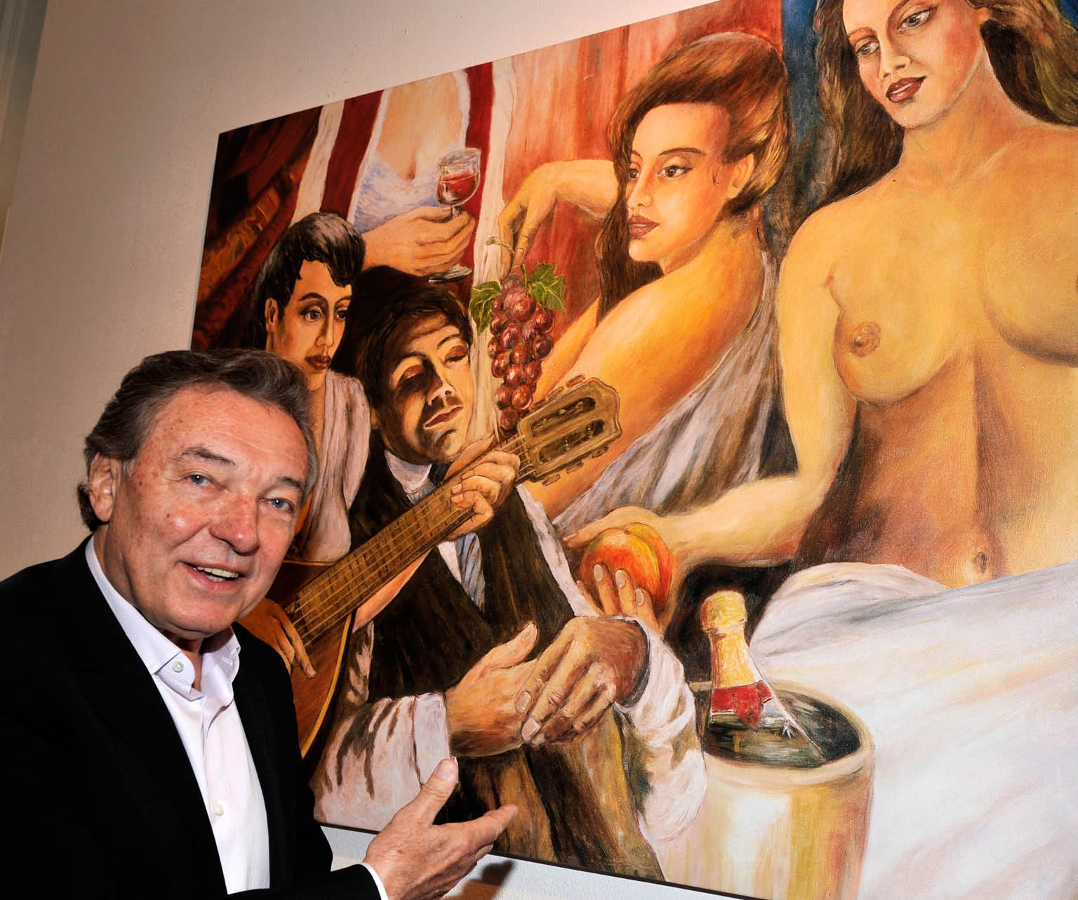 epa02140236 Czech singer Karel Gott poses for photographs in front of his painting entitled 'Sleep, give us a dream' (1999) from his private collection at Mensing Gallery in Munich, Germany, 02 May 2010. The exhibit 'Karel Gott, painter' runs until 10 May 2010.  EPA/URSULA DUEREN