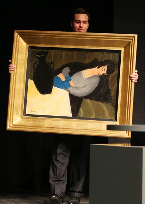 "A staff member of the gallery carries the painting ""Sleeping woman with black vase"" by Hungarian artist Robert Bereny during an auction at the Judit Virag Gallery in Budapes on December 13, 2014. A long-lost avant-garde painting went under the auction hammer Saturday in Hungary, after a sharp-eyed art historian rediscovered it being used as a prop in the Hollywood film ""Stuart Little""., Image: 213132208, License: Rights-managed, Restrictions: RESTRICTED TO EDITORIAL USE - MANDATORY MENTION OF THE ARTIST UPON PUBLICATION - TO ILLUSTRATE THE EVENT AS SPECIFIED IN THE CAPTION, Model Release: no, Credit line: Profimedia, AFP"