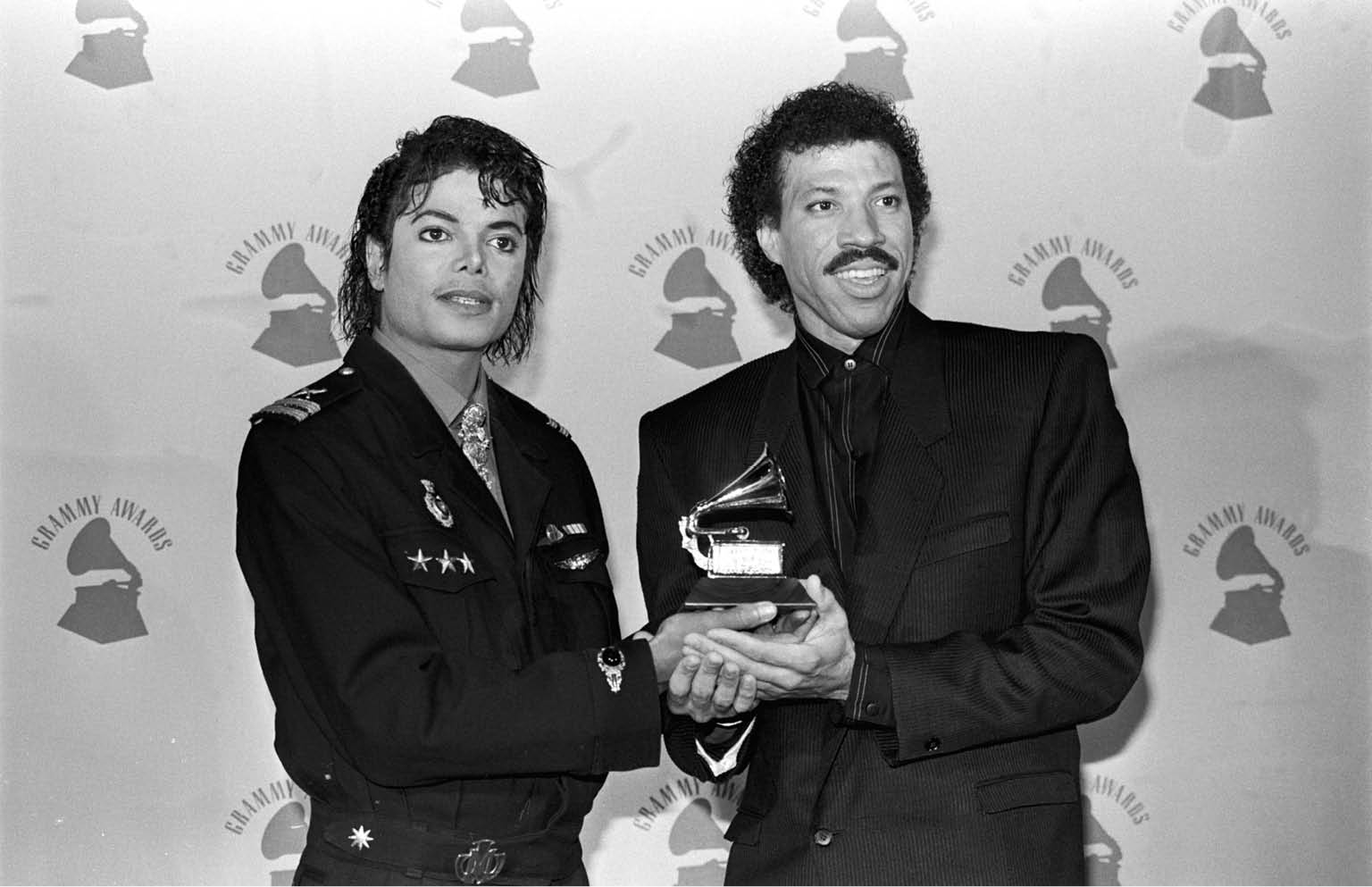 "Singer-songwriters Michael Jackson and Lionel Ritchie hold their Grammy Award for ""We Are the World""., Image: 15371186, License: Rights-managed, Restrictions: , Model Release: no, Credit line: Profimedia, Corbis"