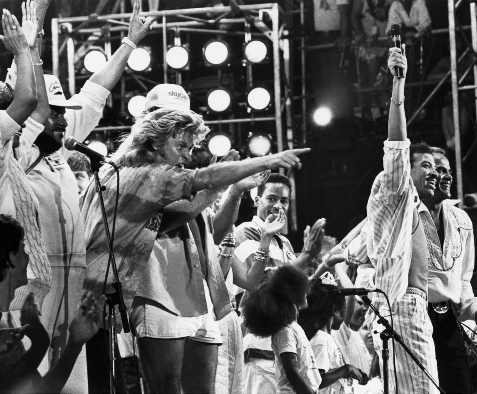 "Original caption: 7/13/1985-Lionel Richie and Harry Belafonte are joined by other performers at the Live Aid concert in Philadelphia as they all sing the concert-ending song of ""We Are The World."", Image: 14910251, License: Rights-managed, Restrictions: , Model Release: no, Credit line: Profimedia, Corbis"