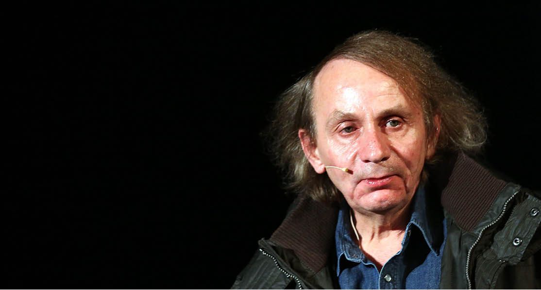 epa04569675 French author Michel Houellebecq looks on during the presentation of his new novel 'Soumission (Submission)' in Cologne (North Rhine-Westphalia), Germany, 19 January 2015.  EPA/OLIVER BERG